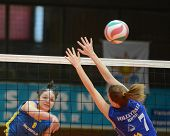 KAPOSVAR, HUNGARY - FEBRUARY 13: Barbara Balajcza (L) strikes the ball at the Hungarian NB I. League