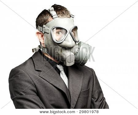 portrait of a business man with gas mask over white background