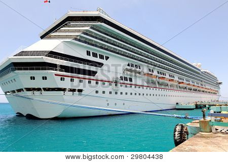 Passenger cruise ship at port in Caribbean waters