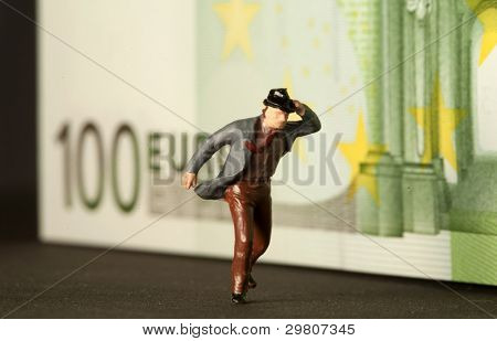 A one hundred euro bill with a figure of a man escaping worrying.