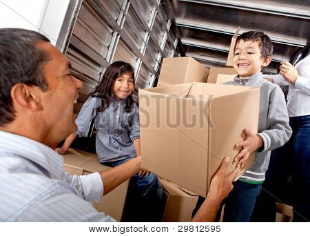 Family moving house loading a truck with boxes