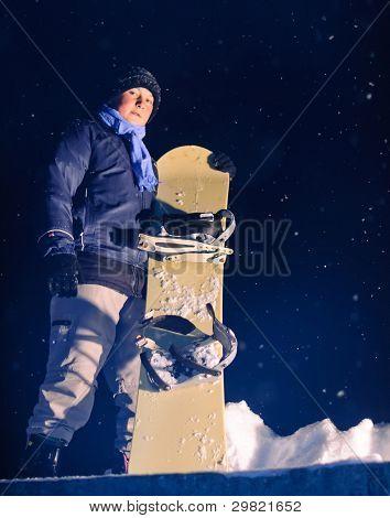 Boy holding snowboard