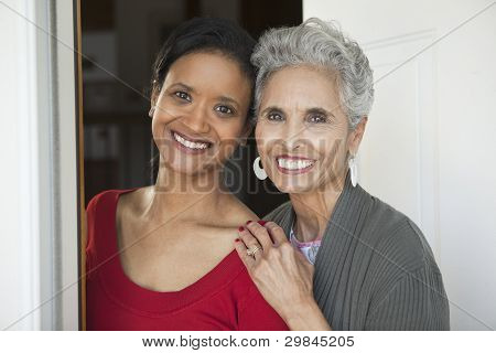 Mother And Daughter At The Front Door