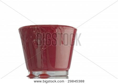 A spilling glass of smoothie