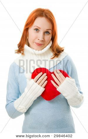 Beautiful girl in warm clothes with a heart