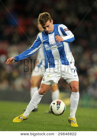 BARCELONA - FEB, 4: Antoine Griezmann of Real Sociedad in action during the Spanish league match against FC Barcelona at the Camp Nou stadium on February 4, 2012 in Barcelona, Spain