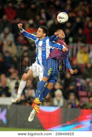 BARCELONA - FEB, 4: Liassine Cadamuro(L) of Real Sociedad vies with Dani Alves(R) of FC Barcelona during the Spanish league match at the Camp Nou stadium on February 4, 2012 in Barcelona, Spain