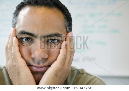 Close up portrait of man with hands on face