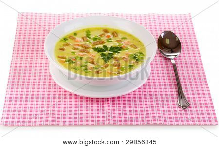 Tasty soup on pink napkin isolated on white