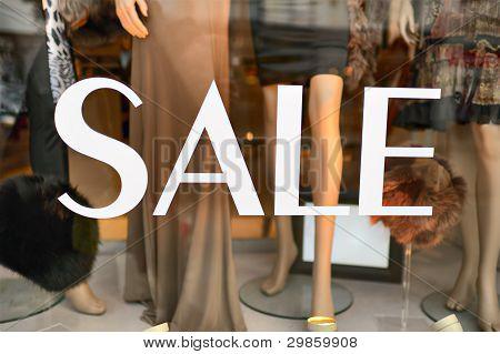 Sale Sign In A Fashion Shop Window