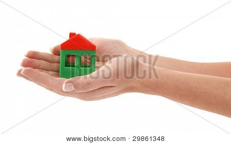 Hands are holding house