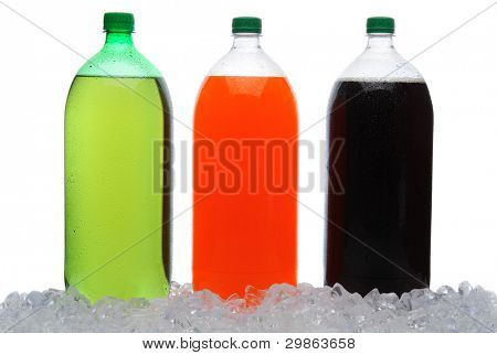 Assorted large soda bottles standing in ice and covered with condensation. Horizontal format over a white background.