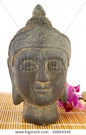 Buddha statue with pink Orchid and bamboo