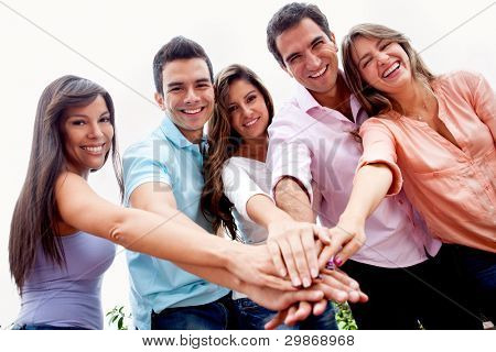 Casual group of people with hands together in the center - teamwork concepts