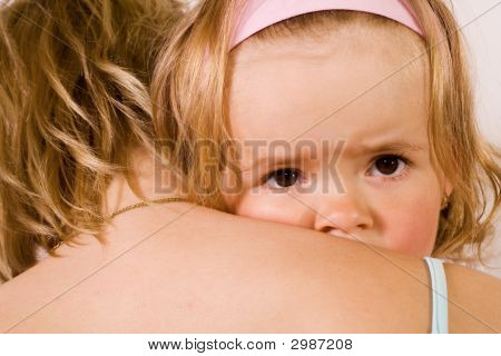 Little Girl Cuddling With Her Mother - Closeup