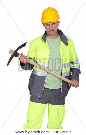 A man holding a pickaxe with a serial killer face.