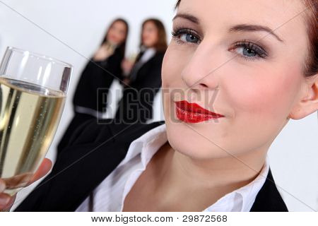 successful businesswoman drinking champagne