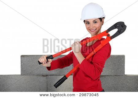 female builder holding bolt cutters