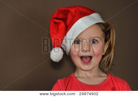 Suprised girl in santa cap