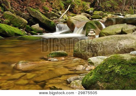 Mountain river stream with moss rocks