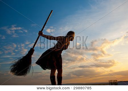 pretty witch with broom