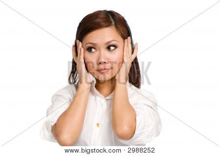 Woman Enjoying Listen On Her Headphone