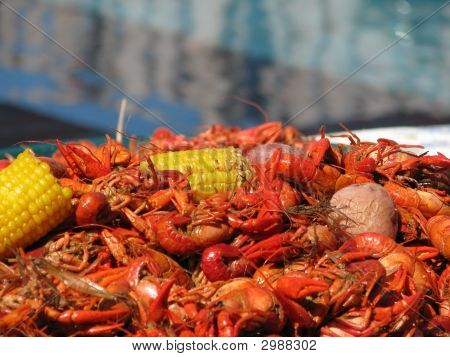 Crawfish Corn And Potatoes With Pool Blurred In Background