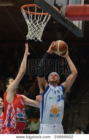 KAPOSVAR, HUNGARY - JANUARY 28: Michael Fey (with ball) in action at a Hungarian Championship basketball game with Kaposvar (white) vs. Nyiregyhaza (red) on January 28, 2012 in Kaposvar, Hungary.