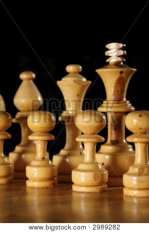Close Up Of Wooden Chess Pieces On Black