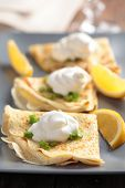 Crepes with cream fraiche, green onion and lemon