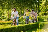Young Happy Bikers Cycling Outdoors. Group Of Cheerful Friends Cycling During Sunny Day. Perfect Day poster