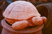 Statue In The Form Of A Large Earth Tortoise Or Large Tortoise. Artistic Work Of A Ceramic Sculptor  poster