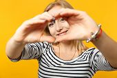Smiling Young Woman In Striped Clothes Showing Shape Heart With Hands, Heart-shape Sign Isolated On  poster