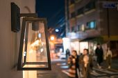 Vintage Street Lamp With Incandescent Lamp In The Street.beautiful Street Lamp In The Evening Agains poster