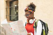 Beautiful Afro American Girl Using A Map. poster