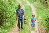 Dad Teaching Son Care Plants. Arbor Day. Planting Trees. Tree Planting Tradition. Little Helper In G poster