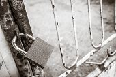Gate Closed With A Padlock - Focus On The Padlock poster