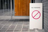 A Rectangular Vertical Sign no Parking Is On The Asphalt In Front Of The House. Sign no Parking  poster