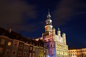 Historic Tenement Houses And The Renaissance Town Hall With A Tower At Night In Poznan poster