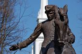 "picture of paul revere  - ""One if by land two if by sea..."" This statue of Paul Revere is in the plaza in front of the Old North Church in Boston where Paul Revere began his famous ride. The building in the background is the Old North Church. - JPG"