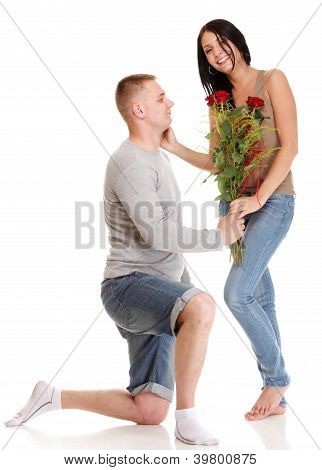 Attractive Young Couple Gift Rose In Hand Isolated