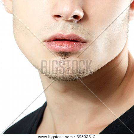 male lips, chin and cheekbone closeup, face detail of young man over white