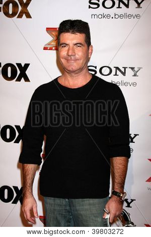 LOS ANGELES - DEC 6:  Simon Cowell arrives to the X Factor 2012 Final Four Party at Rodeo Drive on December 6, 2012 in Beverly Hills, CA