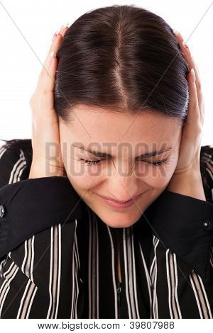 Young Businesswoman Covering Ears With Her Hands
