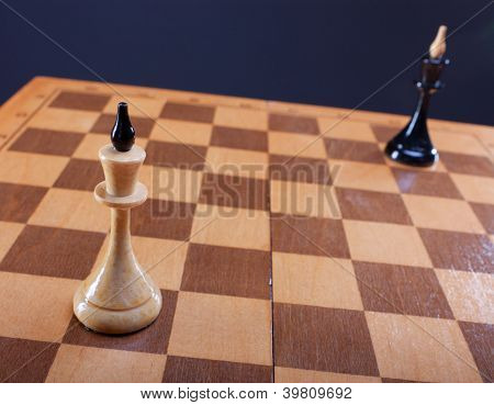 black and white queens on chess board