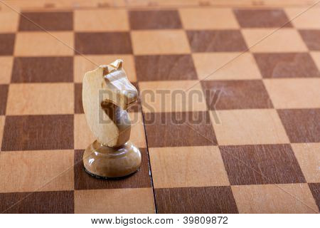knight chess piece on a Board