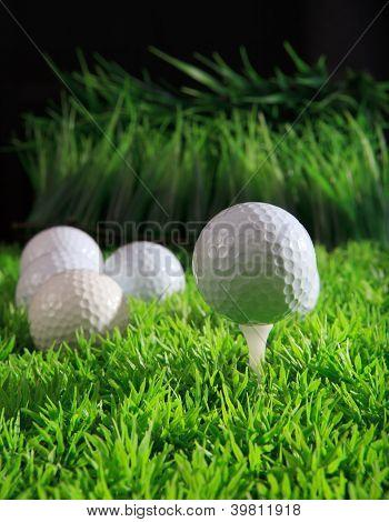 golf ball and green grass field