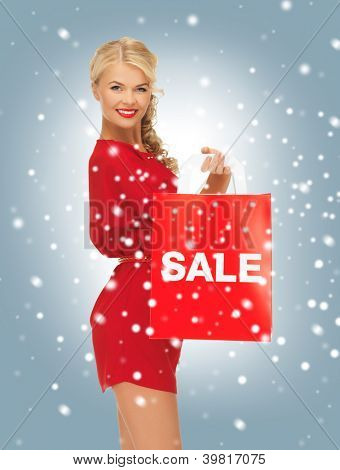 picture of beautiful woman in red dress with shopping bag