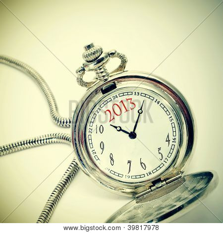 number 2013, the new year, written in a pocket watch, with a retro effect