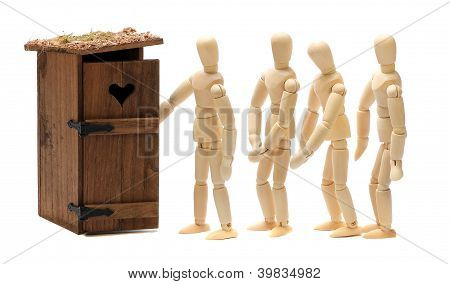 Wooden Dolls Waiting For Toilet